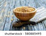 whole grain oats in a wooden... | Shutterstock . vector #580885495