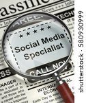 Stock photo social media specialist newspaper with the jobs column in the newspaper with the classified ad of 580930999