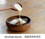 malva pudding with custard... | Shutterstock . vector #580949455