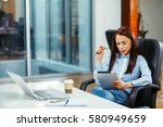young businesswoman working... | Shutterstock . vector #580949659