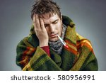 young man suffering from a... | Shutterstock . vector #580956991