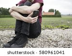 an anonymous young man sitting... | Shutterstock . vector #580961041