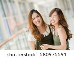 Two Beautiful Young Happy Asia...