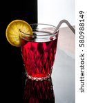 a glass with red drink on a... | Shutterstock . vector #580988149