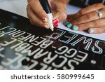 young woman writing cafe menu... | Shutterstock . vector #580999645