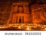 Small photo of Experience Petra by night by walking the entire Siq to the Treasury to see part of the rock city by candlelight with over 1,500 candles, Petra, Jordan.