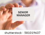 closeup on businessman holding... | Shutterstock . vector #581019637