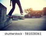 young skateboarder legs riding... | Shutterstock . vector #581028361