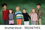 group of children smiling... | Shutterstock . vector #581067451
