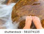Feet In Water Stream