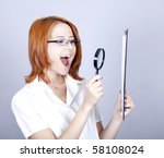 Young businesswomen with white plan board and loupe. - stock photo