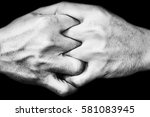 Small photo of hand of man join together on black in white tone, adherence concept