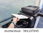 woman put paper into printer... | Shutterstock . vector #581137045