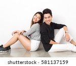 Young Asian Couple Sitting Bac...