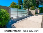 modern gates with driveway to... | Shutterstock . vector #581137654