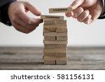 two hands putting dominoes onto ... | Shutterstock . vector #581156131