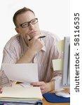 a man doing work at a computer... | Shutterstock . vector #58116535