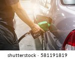 grey car at gas station being... | Shutterstock . vector #581191819
