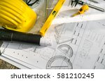 construction plans with helmet... | Shutterstock . vector #581210245