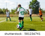 soccer football players running ... | Shutterstock . vector #581236741