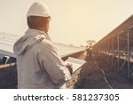 foreman checking job routine of ... | Shutterstock . vector #581237305