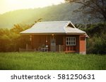 beautiful old wooden house in... | Shutterstock . vector #581250631