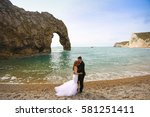 groom and bride on the coast | Shutterstock . vector #581251411