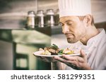 closeup of a male chef with... | Shutterstock . vector #581299351