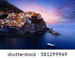 manarola village at twilight.... | Shutterstock . vector #581299969