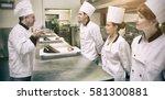 chefs presenting their dessert... | Shutterstock . vector #581300881