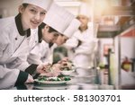 happy chef looking up from... | Shutterstock . vector #581303701