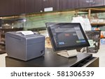 Small photo of Point of Sale retail service computerised terminal in coffee shop. Touch screen tablet based with software interface for waiters with cash register and mobile print terminal.
