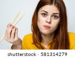 woman chewing sticks sushi meal ... | Shutterstock . vector #581314279