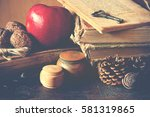 old vintage books on wooden... | Shutterstock . vector #581319865
