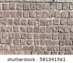 brown wall made of stone with... | Shutterstock . vector #581341561