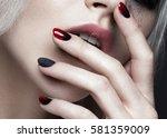 beautiful blond girl with dark... | Shutterstock . vector #581359009