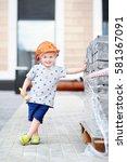 Portrait Of Little Builder In...