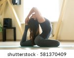 young woman practicing yoga ... | Shutterstock . vector #581370409