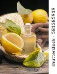 lemon essential oil and lemon... | Shutterstock . vector #581385919