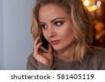 young  woman looking through... | Shutterstock . vector #581405119