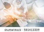 businesswoman doing handshake... | Shutterstock . vector #581413309