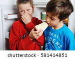 boy is smelling a piece of... | Shutterstock . vector #581414851