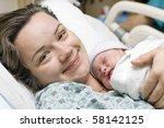 happy mother with newborn baby | Shutterstock . vector #58142125