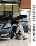 Small photo of Car care staff cleaning the car (Car detailing).