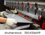 sheet metal bending in factory | Shutterstock . vector #581436649