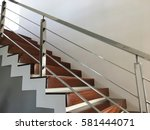 white wall and wood step with... | Shutterstock . vector #581444071