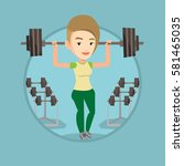 woman lifting a heavy weight... | Shutterstock .eps vector #581465035