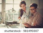 confident team of engineers... | Shutterstock . vector #581490307
