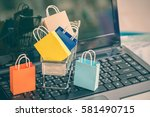 five paper shopping bags in and ... | Shutterstock . vector #581490715