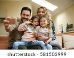 family taking self portrait on... | Shutterstock . vector #581503999